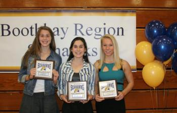 Girls cross-country plaque winners, from left, Kate Friant, Most Improved; Sofia Thayer, Most Valuable; and Morgan Crocker, Coaches Award. KEVIN BURNHAM/Boothbay Register
